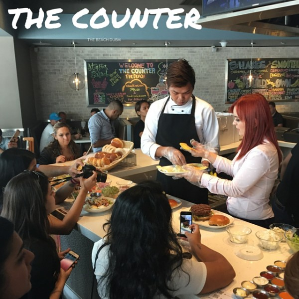 Composing of burger at The Counter